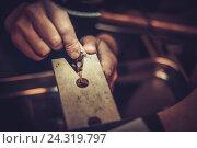 Купить «Jeweler at work in jewelery workshop», фото № 24319797, снято 2 декабря 2016 г. (c) Andrejs Pidjass / Фотобанк Лори