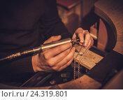 Купить «Jeweler at work in jewelery workshop», фото № 24319801, снято 2 декабря 2016 г. (c) Andrejs Pidjass / Фотобанк Лори