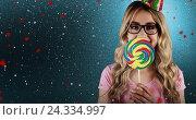 Купить «Composite image of a beautiful hipster holding a giant lollipop», фото № 24334997, снято 22 января 2019 г. (c) Wavebreak Media / Фотобанк Лори