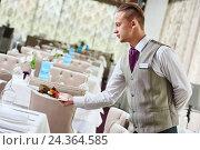 Купить «Restaurant waiter serving table with food», фото № 24364585, снято 10 ноября 2015 г. (c) Дмитрий Калиновский / Фотобанк Лори