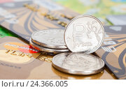 Russian rubles coins over different credit cards close up, фото № 24366005, снято 6 декабря 2016 г. (c) FotograFF / Фотобанк Лори