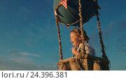 Купить «Happy young boy traveling in a balloon», видеоролик № 24396381, снято 29 ноября 2016 г. (c) Raev Denis / Фотобанк Лори