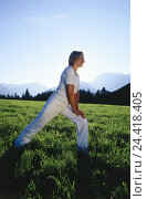 Купить «Meadow, woman, gymnastics, stretching, model released, outside, middle old person, leisure time, hobby, sport, fitness, gymnastics practise, distension...», фото № 24418405, снято 9 сентября 2002 г. (c) mauritius images / Фотобанк Лори