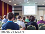 Купить «Люди в лекционном зале», фото № 24420873, снято 4 апреля 2020 г. (c) Matej Kastelic / Фотобанк Лори