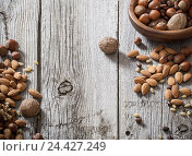Mixed nuts on old wooden background. Стоковое фото, фотограф Майя Крученкова / Фотобанк Лори