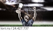 Купить «Composite image 3D of portrait of happy sportsman cheering while holding trophy», фото № 24427737, снято 27 июня 2019 г. (c) Wavebreak Media / Фотобанк Лори