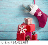 Купить «Christmas stockingwith gifts on wooden wall», фото № 24428681, снято 5 декабря 2016 г. (c) Майя Крученкова / Фотобанк Лори