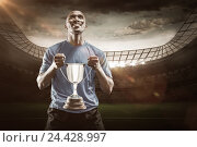 Купить «Composite image 3D of happy athlete holding trophy looking up», фото № 24428997, снято 27 июня 2019 г. (c) Wavebreak Media / Фотобанк Лори