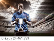 Купить «Composite image 3D of portrait of happy athlete holding trophy», фото № 24461789, снято 27 июня 2019 г. (c) Wavebreak Media / Фотобанк Лори