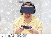 Купить «man in virtual reality headset with controller», фото № 24492081, снято 12 марта 2016 г. (c) Syda Productions / Фотобанк Лори