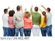 Купить «group of people pointing to something», фото № 24492481, снято 29 октября 2016 г. (c) Syda Productions / Фотобанк Лори