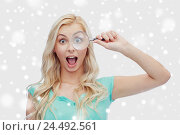 Купить «happy young woman with magnifying glass», фото № 24492561, снято 13 февраля 2016 г. (c) Syda Productions / Фотобанк Лори