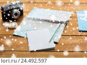Купить «close up of notepad with map and travel tickets», фото № 24492597, снято 8 февраля 2016 г. (c) Syda Productions / Фотобанк Лори