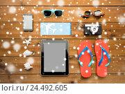 Купить «close up of tablet pc and travel stuff», фото № 24492605, снято 8 февраля 2016 г. (c) Syda Productions / Фотобанк Лори