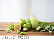 glass of green juice with fruits and vegetables. Стоковое фото, фотограф Syda Productions / Фотобанк Лори