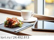 Купить «prosciutto ham salad with tablet pc at restaurant», фото № 24492813, снято 22 сентября 2016 г. (c) Syda Productions / Фотобанк Лори