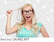 Купить «happy young woman or teenage girl in glasses», фото № 24492997, снято 13 февраля 2016 г. (c) Syda Productions / Фотобанк Лори