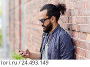 Купить «man with backpack texting on smartphone in city», фото № 24493149, снято 2 июня 2016 г. (c) Syda Productions / Фотобанк Лори