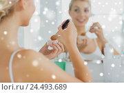 Купить «woman with makeup brush and powder at bathroom», фото № 24493689, снято 13 февраля 2016 г. (c) Syda Productions / Фотобанк Лори