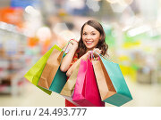 Купить «woman with shopping bags at store», фото № 24493777, снято 22 сентября 2013 г. (c) Syda Productions / Фотобанк Лори