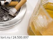 Купить «Ashtray, cigarette, whisky glass, detail, blur,», фото № 24500897, снято 7 апреля 2009 г. (c) mauritius images / Фотобанк Лори
