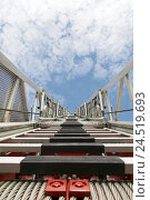 Купить «Fire escape, rungs, clouds, heavens, blue,», фото № 24519693, снято 22 января 2010 г. (c) mauritius images / Фотобанк Лори