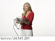 Купить «Woman, middle old person, blond, helplessly, gesture, cable, in a mess, hold, half portrait, model released, people, women's portrait, studio, copy space...», фото № 24541281, снято 15 декабря 2017 г. (c) mauritius images / Фотобанк Лори