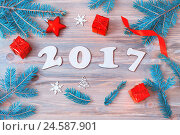 Купить «New Year 2017 background with 2017 figures,Christmas toys, blue fir branches - New Year 2017 festive still life in vintage tones», фото № 24587901, снято 29 ноября 2016 г. (c) Зезелина Марина / Фотобанк Лори