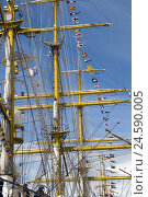 Купить «Decked with flags ship masts,», фото № 24590005, снято 16 августа 2018 г. (c) mauritius images / Фотобанк Лори