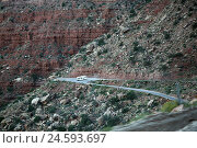 Купить «The USA, Utah, Moki Dugway, plateau, demolition edge, street, design and lay-out of a road, extremely, winding, bendy, dusty, not secured, ban, grit runway...», фото № 24593697, снято 15 августа 2010 г. (c) mauritius images / Фотобанк Лори