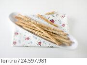 Купить «Knabberstäbchen with sesame in long peel on white subsoil,», фото № 24597981, снято 15 марта 2011 г. (c) mauritius images / Фотобанк Лори