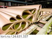 Купить «Картон на бумажной фабрике», фото № 24631337, снято 4 августа 2015 г. (c) Mark Agnor / Фотобанк Лори