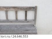 Купить «wooden bank by white outside wall, curled,», фото № 24646553, снято 22 ноября 2010 г. (c) mauritius images / Фотобанк Лори