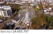Купить «Aerial shot of the russian south city - Krasnodar. Panorama of the city. Ferris wheel. Big wheel. 4K», видеоролик № 24665797, снято 9 декабря 2016 г. (c) ActionStore / Фотобанк Лори