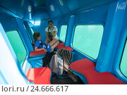 Купить «Мама и дочь внутри субмарины с окнами для водной экскурсии вдоль побережья Адриатического моря», фото № 24666617, снято 5 июня 2016 г. (c) Кекяляйнен Андрей / Фотобанк Лори