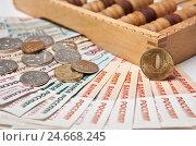 Купить «Деньги с деревянными счетами», фото № 24668245, снято 14 декабря 2016 г. (c) Элина Гаревская / Фотобанк Лори
