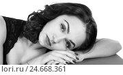 Купить «Woman laying on her hand», фото № 24668361, снято 11 декабря 2016 г. (c) Art Konovalov / Фотобанк Лори