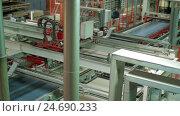 Купить «Automatic Machine Production of chipboard», видеоролик № 24690233, снято 12 декабря 2016 г. (c) Илья Насакин / Фотобанк Лори