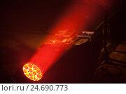 Купить «Bright LED spot light with red beam», фото № 24690773, снято 11 декабря 2016 г. (c) EugeneSergeev / Фотобанк Лори