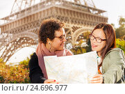 Купить «Two happy women with a paper tourist map in Paris», фото № 24696977, снято 16 октября 2016 г. (c) Сергей Новиков / Фотобанк Лори