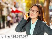 Купить «Happy girl talking on the mobile phone at street», фото № 24697077, снято 16 октября 2016 г. (c) Сергей Новиков / Фотобанк Лори