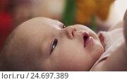 Portrait of little adorable baby lie in crib playing with toys. Cute. Motherhood. Стоковое видео, видеограф Александр Багно / Фотобанк Лори