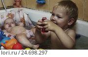 Happy little boy play with toys in bathtub. Baby swim in cradle. Water. Children. Стоковое видео, видеограф Александр Багно / Фотобанк Лори