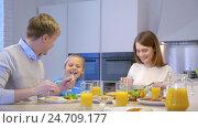 Купить «Smiling family at home», видеоролик № 24709177, снято 19 сентября 2019 г. (c) Raev Denis / Фотобанк Лори