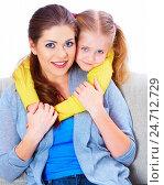 Купить «Young woman play with her daughter on sofa», фото № 24712729, снято 7 марта 2014 г. (c) sheftsoff / Фотобанк Лори