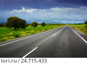 Купить «landscpae with road and heavy clouds», фото № 24715433, снято 12 мая 2016 г. (c) Яков Филимонов / Фотобанк Лори