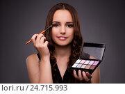 Купить «Woman doing makeup on dark background», фото № 24715993, снято 7 сентября 2016 г. (c) Elnur / Фотобанк Лори
