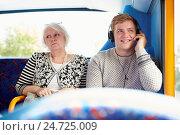 Купить «Man Disturbing Passengers On Bus Journey With Loud Music», фото № 24725009, снято 26 сентября 2013 г. (c) easy Fotostock / Фотобанк Лори