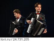 Купить «Братья-аккордеонисты Кирилл и Константин Бондаренко», фото № 24731205, снято 28 июня 2014 г. (c) Free Wind / Фотобанк Лори