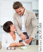 Купить «Son telling elderly mother how to use phone», фото № 24731569, снято 8 июля 2020 г. (c) Яков Филимонов / Фотобанк Лори